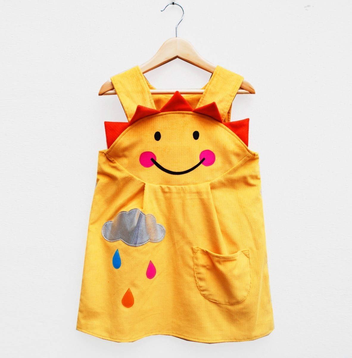 Girls and baby handmade happy sunshine dress in yellow.