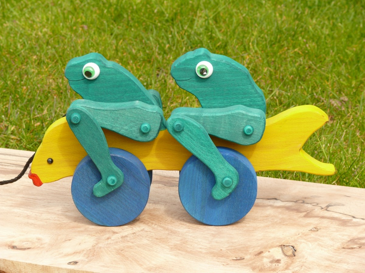 Pull-along cycling frogs